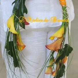 Bouquet de mariée en arceau calla orange et xanadu